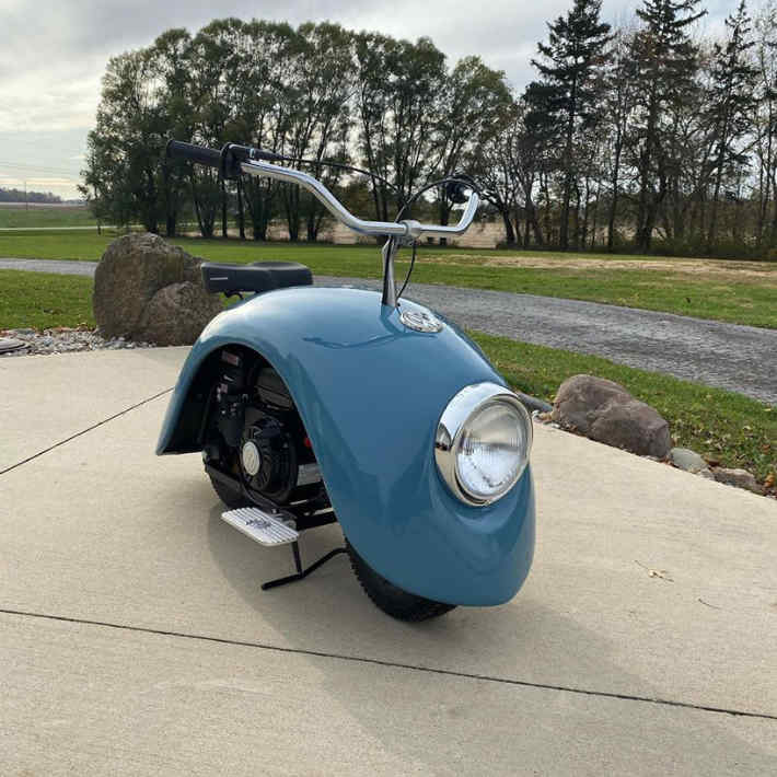 Front of Volkspod minibike upcyclecled out of old VW Beetle car fenders